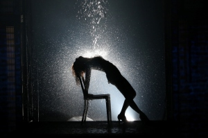 Steelworker/dancer Alex Owens (Jillian Mueller) re-creates an iconic moment from the original movie in Flashdance: The Musical (photo by Jeremy Daniel)