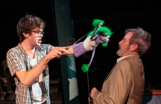 Jason (Danny Turek), a teenager possessed by his demonic hand puppet, threatens Pastor Greg (Jonathan Putnam) in Short North Stage's production of Hand to God. (Photo by Jason Allen)