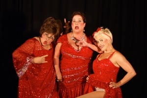 Stephanie Shull, Julie Klein and Stacie Boord (from left) return as the Santa Babies in Holiday Hoopla, opening Thursday at Shadowbox Live (Shadowbox Live photo)