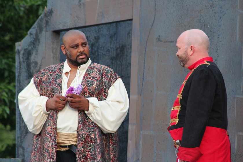 Othello (Christopher C. Austin III) consults with his trusted lieutenant, Iago (Matthew Michael Moore), in Actors' Theatre's production of Othello (photo by Richard Ades)