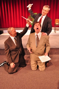 Max Prince (Donovan Johnson, kneeling at right) is attacked by Kenny Franks (Roddey Nagy, left) and Val Slotsky (Aleksandar Bulajic) in a Julius Caesar parody from Laughter on the 23rd Floor (photo by Lillian DeDomenic)