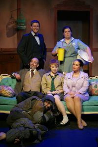 Appearing in The Empire Builders are (from left): standing—Travis Horseman (Neighbor), Audrey Rush (Mug, the maid); seated—Jim Azelvandre (Father), Mary Beth Griffith (Zenobia), Mary-Aileen St. Cyr (Mother); on floor—Stefan Langer (the Schurz) (photo courtesy of MadLab/Shepherd Productions)