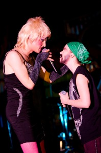 Hedwig (JJ Parkey, left) and Yitzhak (Ruthie Stephens) trade notes in Hedwig and the Angry Inch (photo by Heather Wack)