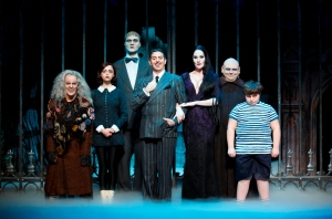 Stars of The Addams Family include (from left) Amanda Bruton (Grandma), Jennifer Fogarty (Wednesday), Dan Olson (Lurch), Jesse Sharp (Gomez), KeLeen Snowgren (Morticia), Shaun Rice (Uncle Fester) and Jeremy Todd Shinder (Pugsley). Note: Alternate actors play Lurch and Pugsley in the current touring production. (photo by Carol Rosegg)