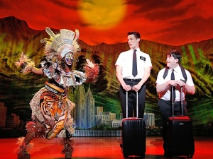 Elder Price (Mark Evans, left) and Elder Cunningham (Christopher John O'Neill) are given a rousing sendoff as they prepare to take the Mormon message to Uganda (Broadway.com photo)