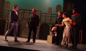 Jean Valjean (Bill Hafner, left) risks being recognized by Javert (Scott Green, center) when he intercedes on behalf of Fantine (Melissa Muguruza), who's being detained by two local constables (Derryck Menard and Emerson Elias) in this scene from Les Miserables (photo by Jerri Shafer)