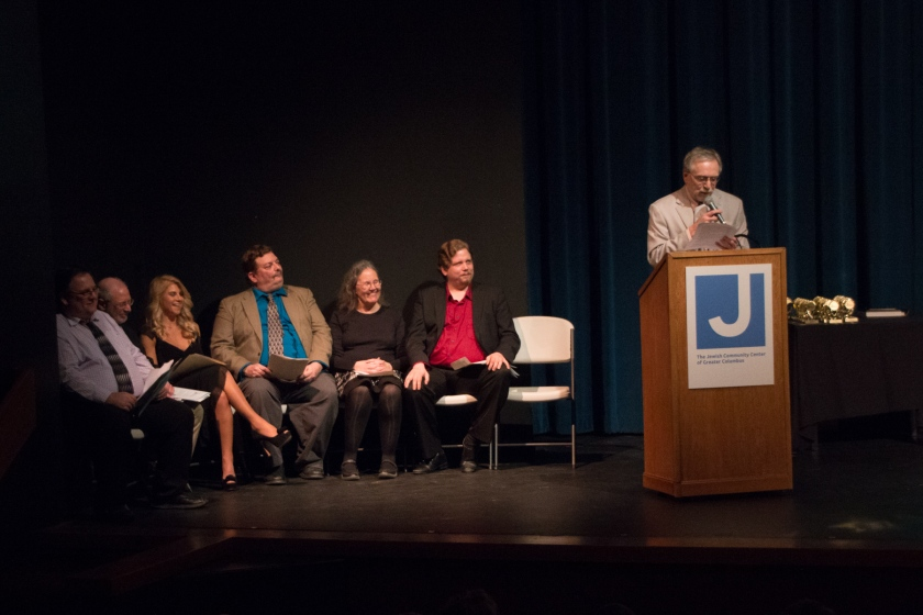Taking part in the Theatre Roundtable's 2016 Awards Night are critics (from left) Paul Batterson, Jay Weitz, Christina Mancuso, Michael Grossberg, Margaret Quamme, Richard Sanford and (at the podium) Richard Ades (photos by Jerri Shafer)