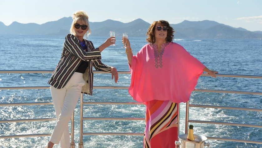Patsy (Joanna Lumley, left) and Eddy (Jennifer Saunders) toast what they hope is their good fortune in Absolutely Fabulous: The Movie