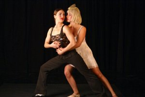 Gatsby (Amy Lay, left) gets reacquainted with the love of her life, Daisy (Miriam King). (Shadowbox Live photo)