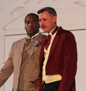 Lord Goring (Amari Ingram, left) hears a startling confession from his friend Sir Robert Chiltern (Ross Shirley).