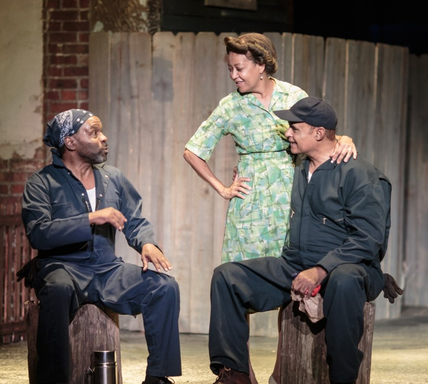 Troy Maxson (Mujahid Abdul-Rashid, right) shares a conversation with co-worker Bono (Victor Little) and wife Rose (Rita Gregory) in an early scene from Fences. (photos by Jason Allen)