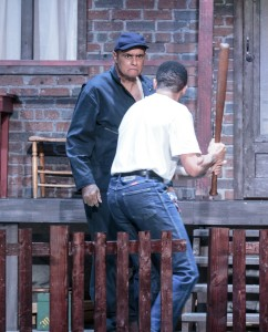 Corey (Taylor Moss) picks up a bat in a confrontation with his father, Troy (Mujahid Abdul-Rashid).