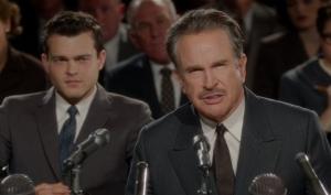Frank Forbes (Alden Ehrenreich, left) listens as Howard Hughes (Warren Beatty) testifies before Congress in Rules Don't Apply.